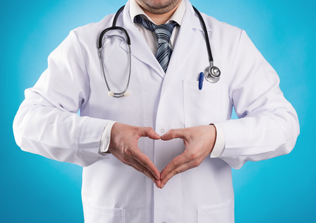 cardiologist: Male doctor cardiologist showing heart shape