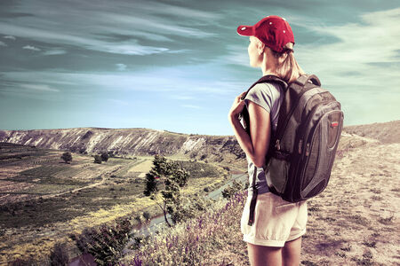 hiils: Female climber looking at beautiful mountain landscape Stock Photo