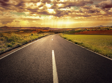 Scenery of asphalt road through agricultural fields. Stockfoto