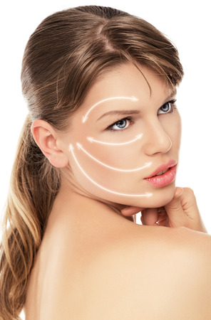 Close-up portrait of lovely female patient of plastic surgery. Pretty Caucasian woman with lifting treatment on her face, isolated over white background.