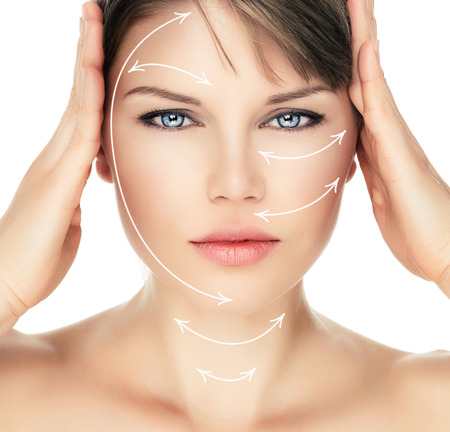 healthcare and beauty: Laser therapy on pretty woman face over white background. Young attractive Caucasian female ready for cosmetic operation.