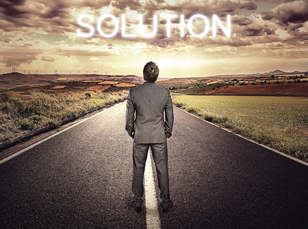 straight path: Businessman standing on highway over beautiful sky background. Concept of straight path to problem solution.