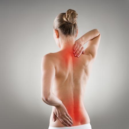 epaule douleur: Lumbago et le concept épine dorsale extensible. Femme dos douloureux Banque d'images