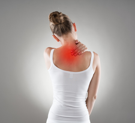 shoulder problem: Neck cramp. Young woman having back illness.