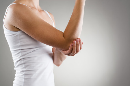fracture arm: Elbow bone fracture. Female having pain in injured arm. Stock Photo