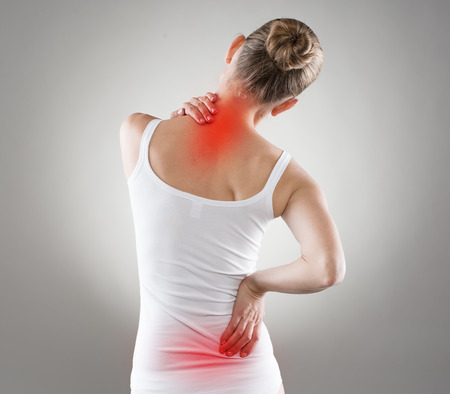 pain: Spine osteoporosis. Scoliosis. Spinal cord problems on womans back.