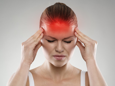 Woman having headache or dizziness problem. Health care and treatment concept. Stock fotó