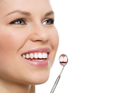 oral cavity: Oral cavity and teeth cure. Beautiful female with dental mirror Stock Photo