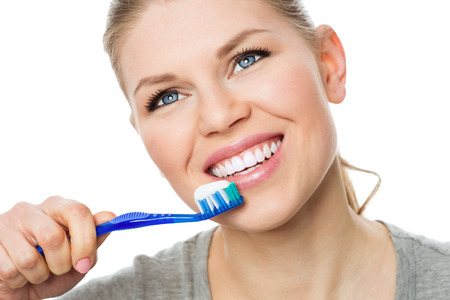 clean teeth: Portrait of beautiful smiling woman with perfect white teeth holding toothbrush ready to clean her mouth.