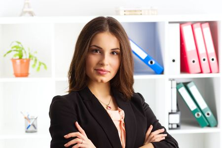 financial adviser: Young attractive woman legal adviser waiting clients in the office. Concept of authority and expertise. Stock Photo