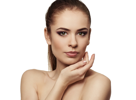 skin protection: Close-up of beautiful brunette model touching her clean healthy skin. Facial lifting and skin protection concept.
