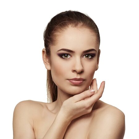 Beauty model woman face. Perfect skin. Professional makeup. Facial therapy and treatment.