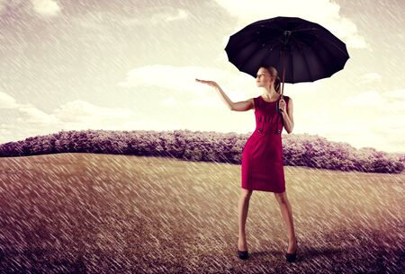 difficulties: Fashionable female with umbrella standing on highway at sunny day. Concept of protection from trouble or difficulties. Successful business.