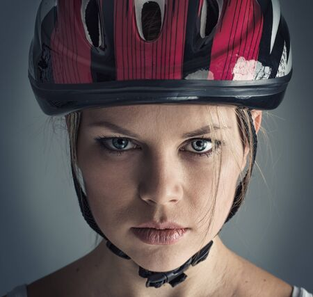 racing bicycle: Woman wearing biking helmet. Close-up portrait of female cyclist.