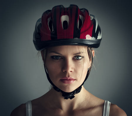 Woman wearing biking helmet. Close-up portrait of female cyclist.