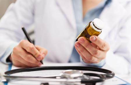 drug test: Closeup of woman medic writing medical record.  Stock Photo