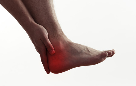 Legs and heels: Male with foot pain or injury. Heel spur problem and therapy.