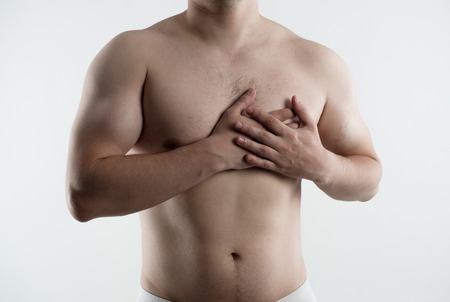 red breast: Heart disease, protect and treatment. Male suffering from  illness. Stock Photo