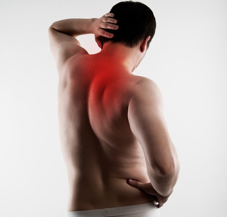 muscle spasm: Torso of young man having backbone problem indicated with red. Neck and back pain. Scoliosis treatment concept Stock Photo