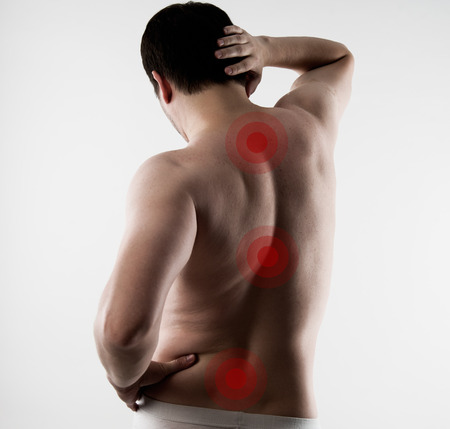 muscle spasm: Shiatsu treatment on male back. Young person with backache. Health care and medicine.