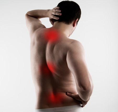 muscle spasm: Reflexology. Spinal pain cure. Body of young Caucasian male with red points on painful zones.