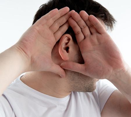 deafness: Closeup of man ear. Male suffering from deafness. Stock Photo