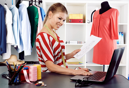 posting: Young fashion blogger posting news online. Creation and ideas. Stock Photo