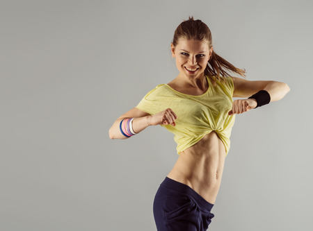 'fit body': Happy hip hop dancer at workout in studio. Healthy lifestyle concept. Stock Photo