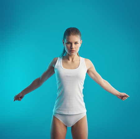 muscle tension: Body rehabilitation. Young woman doing stretching exercise for arms and spine. Muscles recovery concept.