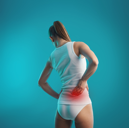 spinal disks: Back nerve spasm. Young female touching right side of body in pain. Loin problem or injury on woman torso.