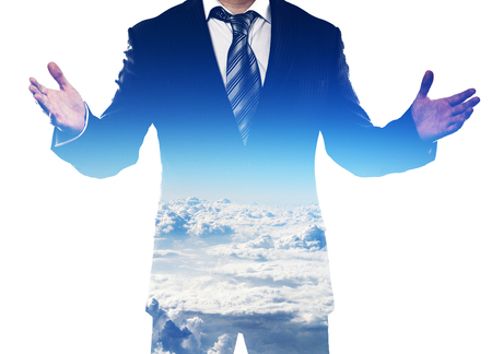 Double exposure of businessman with open arms and clear blue cloudy sky. Concept of belief, achievement and success.
