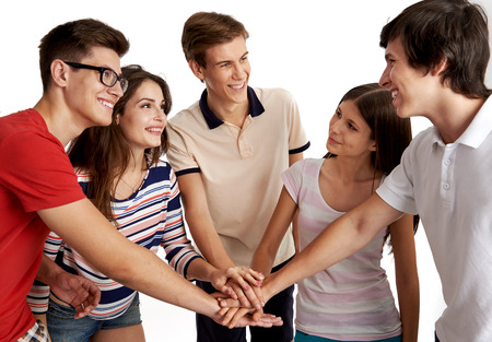 trust people: Students community. Smiling group of people with outstretched arms looking at each other. Concept of trust, achievement and result.