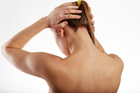 Young woman suffering from neck pain. Backbone disease treatment.