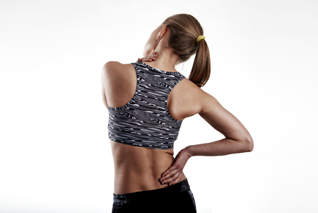 relief: Fitness woman in sportswear touching her painful body. Rheumatism problem concept.