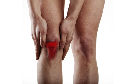 Woman suffering from knee pain. Anatomy and medicine concept. photo
