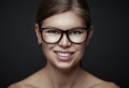 Beautiful smiling woman in optical eyeglasses. Optometry concept. photo