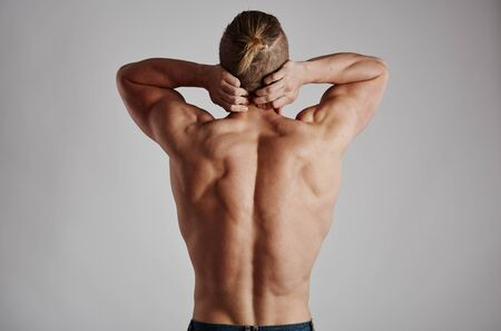 Backache on male body. Concept of spinal disease, treatment and therapy.