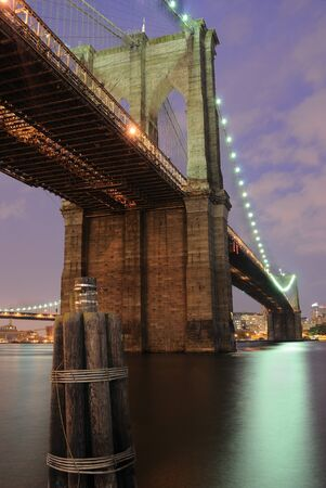 The Brooklyn Bridge shimmering at night. photo