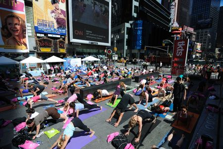 times square: New York City, USA - June 21, 2010 - Participants in Yoga in Times Square Editorial