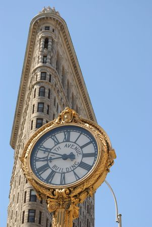 New York, New York, July 2, 2010 - The historic Flatiron Building and 5th Avenue Clock in New York City.