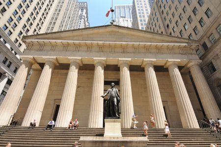 federal hall: New York, New York, July 12, 2010 - Federal Hall in Downtown Manhattan, site of the first Capitol of the United States, with tourists relaxing on the steps.