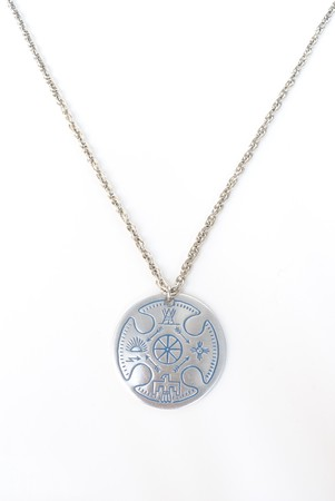 circular chain: A silver necklace with native american designs. Stock Photo