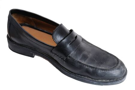 loafer: a black dress shoe on white