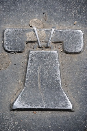 A depiction of the liberty bell on a Philadelphia manhole cover. photo