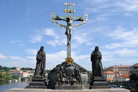 Statues on Charles Bridge in Prague depicting Jesus with Hebrew inscription. Stock Photo - 7870423
