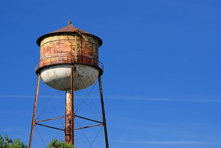 Rusty grungy water tower in the sky Stock Photo - 8144302