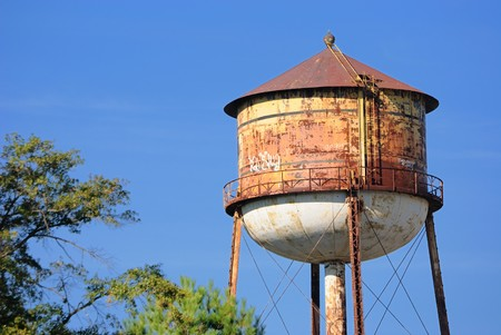 Rusty grungy water tower in the sky Stock Photo - 8144310
