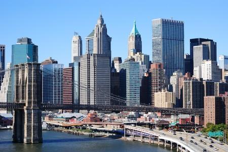 The Brooklyn Bridge leading into numerous Manhattan skyscrapers in New York City. photo