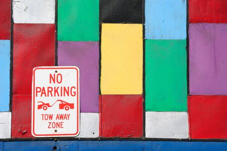 Abstract wall with colorful rectangles and a no parking sign. photo