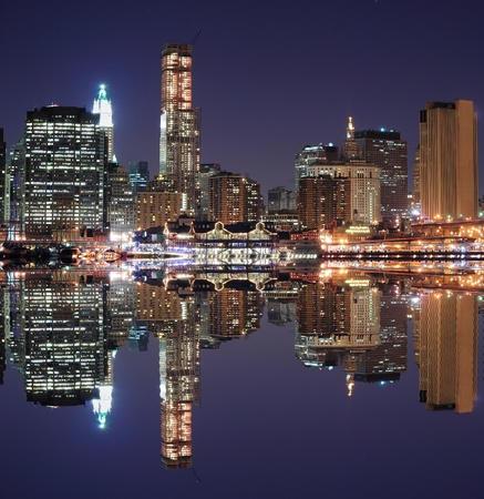 The Lower Manhattan Skyline with serious reflections in New York City.